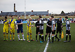 The players shaking hands on to the pitch at Victory Park, before Chorley played Altrincham (in yellow) in a Vanarama National League North fixture. Chorley were founded in 1883 and moved into their present ground in 1920. The match was won by the home team by 2-0, watched by an above-average attendance of 1127.