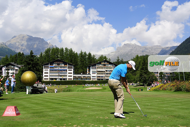 Danny Willett (ENG) tees off the par3 8th tee where a kilo gold bar awaits a hole in 1 during Friday's Round 1 of the 2013 Omega European Masters held at Crans Montana Golf Club, Crans-Sur-Sierre Switzerland. 6th September 2013.<br /> Picture: Eoin Clarke www.golffile.ie