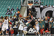 Miami guard Riquna Williams attempts to make a basket in the second half. This game was one of the two Semifinal games of the 2011 ACC Tournament in Greensboro on Saturday, March 5, 2011. UNC beat Miami 83-57. (Photo by Al Drago)