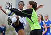 New Hyde Park, NY - November 11, 2009: South Side High School senior No. 21 Crystal Dunn, left, and Division Avenue goalie Brianna Spitaliere narrowly avoid a collision during the Nassau County varsity girls' soccer Class A final at Tully Park. After becoming a four-time All-American at the University of North Carolina and winning the Hermann Award in 2013, Dunn was selected first overall by the Washington Spirit in the 2014 National Women's Soccer League College Draft. (Photo by James Escher)