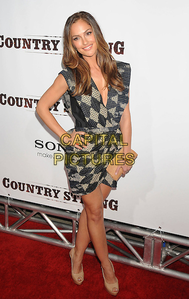 "MINKA KELLY.""Country Strong"" Los Angeles Special Screening held at The Academy of Motion Picture Arts & Sciences, Beverly Hills, California, USA..December 14th, 2010.full length black beige sleeveless dress wrap print clutch bag beige shoes hand on hip.CAP/ROT/TM.©Tony Michaels/Roth Stock/Capital Pictures"