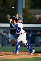 Burlington Royals catcher Colton Frabasilio (18) catches a pop fly during the game against the Bluefield Blue Jays at Burlington Athletic Park on June 29, 2015 in Burlington, North Carolina.  The Royals defeated the Blue Jays 4-1. (Brian Westerholt/Four Seam Images)