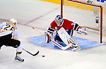 22 November 2008: Boston Bruins' right wing forward Blake Wheeler scores against Montreal Canadiens' goaltender Carey Price during an overtime shootout at the Bell Centre in Montreal, Quebec, Canada.  After a 2-2 regulation tie and a non-scoring 5-minute overtime period, the Boston Bruins scored the lone shootout goal thus defeating the Canadiens 3-2. The Canadiens, celebrating their 100th season, honored former Montreal goaltender Patrick Roy, and retired his jersey (Number 33) during pre-game ceremonies. ***** Editorial Use Only *****..Mandatory Photo Credit: Ed Wolfstein Photo *** Editorial Sales through Icon Sports Media *** www.iconsportsmedia.com