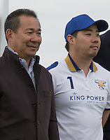 King Power Chairman and CEO / Leicester City Owner Vichai Srivaddhanaprabha (left) with his son Aiyawatt Srivaddhanaprabha (King Power Foxes) after his teams victory during the Cartier Queens Cup Final match between King Power Foxes and Dubai Polo Team at the Guards Polo Club, Smith's Lawn, Windsor, England on 14 June 2015. Photo by Andy Rowland.