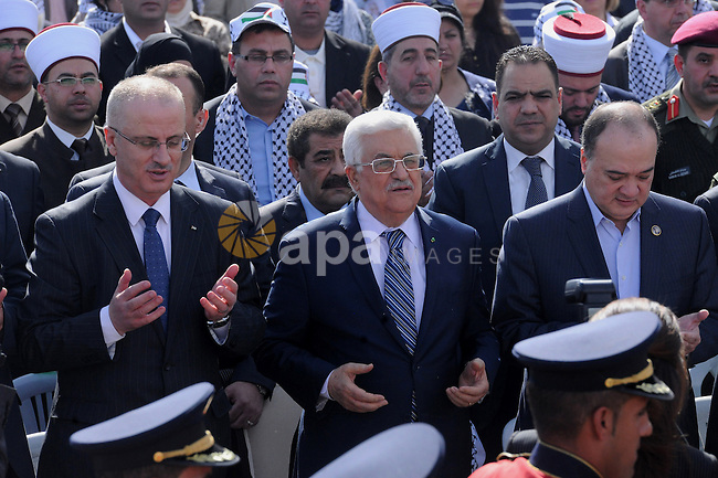 Palestinian President Mahmoud Abbas attends a ceremony marking the 10th anniversary of Yasser Arafat's death, in the West Bank city of Ramallah, on Nov. 11, 2014. Photo by Thaer Ganaim