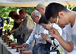 August 15, 2014, Tokyo, Japan - Citizens offer prayers to the war dead at Chidorigafuchi National Cemetery in Tokyo on Friday, August 15, 2014, as Japan observes the 69th anniversary of the nation's surrender in World War II.  (Photo by Katsumi Kasahara/AFLO) AYF -mis-