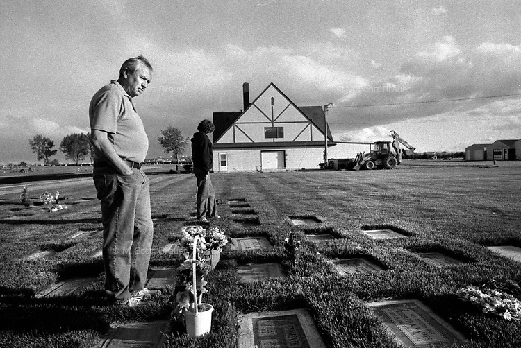 Harold (left) and Connie Brauer visit the gravesite of Connie's parents Nick and Helen Haburchak in Cut Bank, Montana.