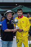 Aizaz Khan of City Kaitak (R) is presented with the trophy by Eddit Middleton of KPMG (L) after the final match of the Hong Kong T20 Blitz between Kowloon Cantons and City Kaitak at Tin Kwong Road Recreation Ground, Hong Kong, China. Photo by Chris Wong / Power Sport Images