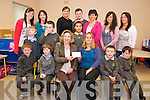 Susan Clifford, Cullina National School parent, pictured as she presented a donation to Elizabeth Forde, Brothers of Charity, Kerry Autism Service, from a quiz held recently by the children of Beaufort Parish. Also pictured are Eoin O'Sullivan, Darragh O'Donoghue, Cormac Daly, Tiernan Daly, Lajoya Mollenhauer, Dylan Hyde, Kieranb Cocquyt, Dermot O'Leary, Emma Dennehy, Marie Counihan, Karen Lucey, Siobhan O'Shea, Lisa Dennehy and Sandra Walsh.