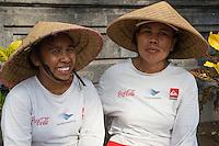 Bali, Indonesia.  Two Women Street Sweepers.  Jimbaran.