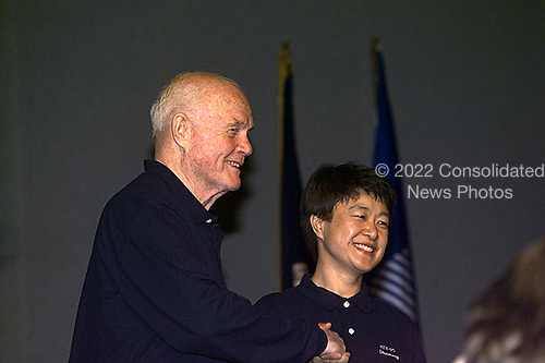 United States Senator John H. Glenn (Democrat of Ohio) shakes hands with Dr. Chiaki Mukai following a press confrence for the STS-95 crew in Houston, Texas on February 20, 1998.  Glenn will fly on the mission as a payload specialist.  Dr. Mukai, making her second flight in space will also fly as a payload specialist representing Japan's National Space Development Agency (NASDA) ..Credit: NASA via CNP