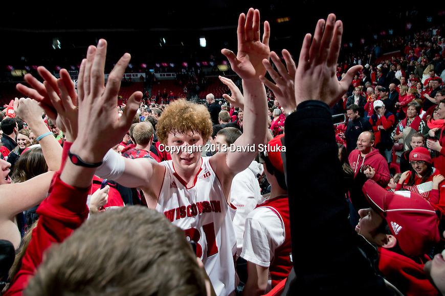 Wisconsin Badgers forward Mike Bruesewitz (31) celebrates with fans after a Big Ten Conference NCAA college basketball game against the Michigan Wolverines Saturday, February 9, 2013, in Madison, Wis. The Badgers won 65-62 (OT). (Photo by David Stluka)