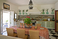 The Spanish wine bottles on the shelf above the kitchen units were found during the house's refurbishment
