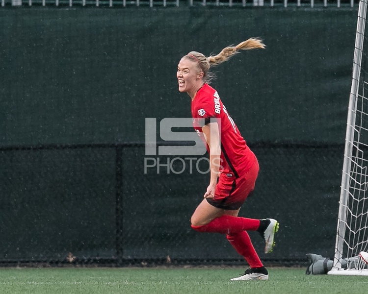 Allston, Massachusetts - May 1, 2016:  In a National Women's Soccer League (NWSL) match, Portland Thorns FC (red) defeated Boston Breakers (blue), 1-0, at Jordan Field.<br /> <br /> Goal celebration.