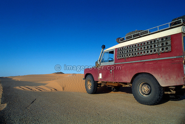 Algeria, Africa, Sahara. Land Rover on a typical sandy road in the southern part of Algeria. --- Property release available. Automotive trademarks are the property of the trademark holder, authorization may be needed for some uses.