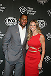 Michael Strahan and Erin Andrews  at FOX Sports 1 celebrates the official Thursday Night Super Bash at Time Warner Cable Studios. Hosts Michael Strahan and Erin Andrews Superbowl week, NY