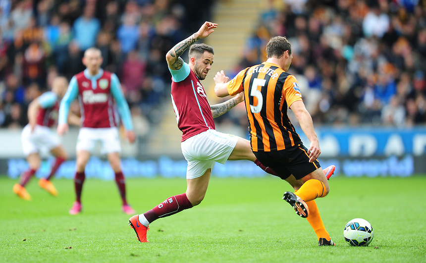 Hull City's James Chester clears under pressure from Burnley's Danny Ings<br /> <br /> Photographer: Chris Vaughan/CameraSport<br /> <br /> Football - Barclays Premiership - Hull City v Burnley - Saturday 9th May 2015 - Kingston Communications Stadium - Hull<br /> <br /> &copy; CameraSport - 43 Linden Ave. Countesthorpe. Leicester. England. LE8 5PG - Tel: +44 (0) 116 277 4147 - admin@camerasport.com - www.camerasport.com