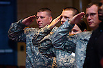 Local Army reservists salute during the playing of the National Anthem during a ceremony honoring veterans for Veterans Day at Curtin Middle School Tuesday.
