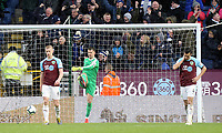 (from left) Burnley's Ben Mee, Thomas Heaton and Jack Cork look dejected after Leicester City's Wes Morgan (not pictured) scored his sides winning goal <br /> <br /> Photographer Rich Linley/CameraSport<br /> <br /> The Premier League - Burnley v Leicester City - Saturday 16th March 2019 - Turf Moor - Burnley<br /> <br /> World Copyright © 2019 CameraSport. All rights reserved. 43 Linden Ave. Countesthorpe. Leicester. England. LE8 5PG - Tel: +44 (0) 116 277 4147 - admin@camerasport.com - www.camerasport.com