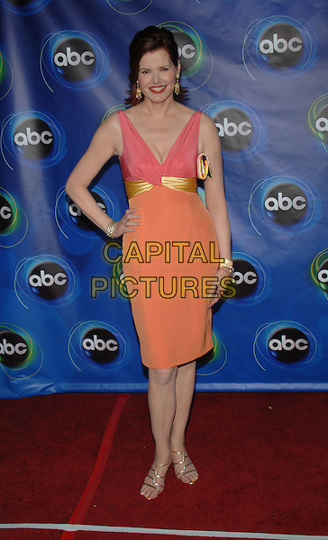 GEENA DAVIS.ABC 2005 Summer Press Tour Party held at the Abby..West Hollywood, California..USA, United States.27th July 2005.Ref: ADM/JW.full length orange peach pink gold belted high waisted hand on hip matching bangles bracelets accessories jewellery posed.www.capitalpictures.com.sales@capitalpictures.com.© Capital Pictures.