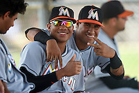 GCL Marlins Jonathan Richards (4) and Rony Cabrera (6) during a game against the GCL Nationals on June 28, 2014 at the Carl Barger Training Complex in Viera, Florida.  GCL Nationals defeated the GCL Marlins 5-0.  (Mike Janes/Four Seam Images)