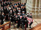 The casket containing the remains of former United States President Gerald R. Ford is carried by a military honor guard into the Washington National Cathedral, in Washington, D.C. on Tuesday, January 2, 2007. In the front row are: President George W. Bush,first lady Laura Bush,Vice President Dick Cheney, Lynne Cheney,former President Jimmy Carter, former first lady Roslyn Carter, and former first lady Nancy Reagan.  In the second row are former President George H.W. Bush, former first lady Barbara Bush, Doro Bush Koch, former President Bill Clinton, former first lady Senator Hillary Rodham Clinton (Democrat of New York), Chelsea Clinton, Secretary of State Condoleezza Rice, Secretary of the Treasury Henry M. Paulson, Jr., and Secretary of Defense William Gates.  Jack Ford looks on from far left.<br /> Credit: Ron Sachs / CNP<br /> <br /> [NOTE: No New York Metro or other Newspapers within a 75 mile radius of New York City]
