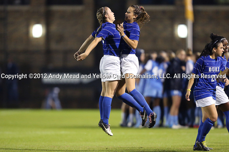18 October 2012: Duke's Libby Jandl (left) and Katie Trees (right) chest bump before the game. The University of North Carolina Tar Heels defeated the Duke University Blue Devils 2-0 at Koskinen Stadium in Durham, North Carolina in a 2012 NCAA Division I Women's Soccer game.