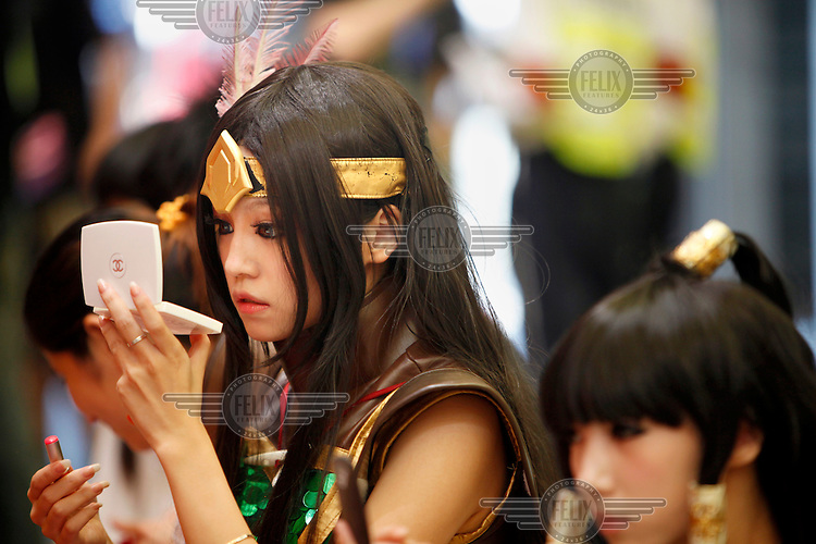 Cosplayers apply make up and wait perform at the ChinaJoy Expo, also know as the China Digital Entertainment Expo and Conference. Online and social network games have become hugely popular in China particularly as children lack the space and facilities required for traditional sports.