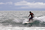 Central America, Costa Rica, Manuel Antonio.  Surfer at Manuel Antonio.