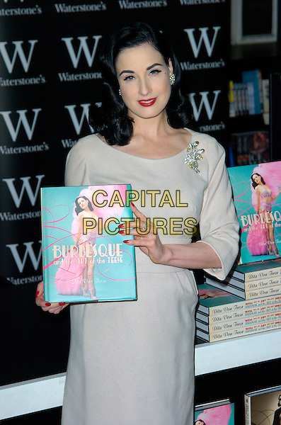 "DITA VON TEESE .At Waterstone's to sign her book ""Burlesque & The Art Of The Teese"", London, England. .November 22nd, 2007.half length beige dress brooch cream nail varnish polish ring .CAP/CAN.©Can Nguyen/Capital Pictures"