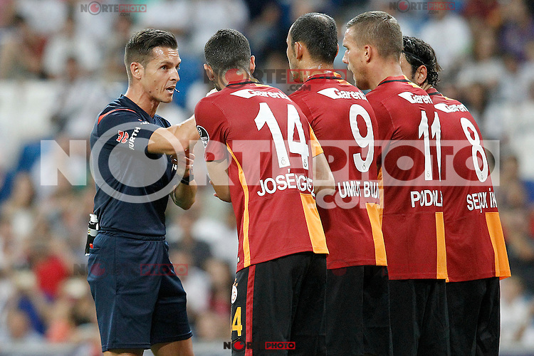 Spanish referee Carlos del Cerro Grande have words with Galatasaray's Jose Rodriguez, Umut Bulut, Lukas Podolski and Selcuk Inan during XXXVI Santiago Bernabeu Trophy. August 18,2015. (ALTERPHOTOS/Acero)