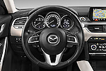 Car pictures of steering wheel view of a 2015 Mazda Mazda 6 Skycruse 5 Door Wagon Steering Wheel