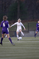 "Boston College midfielder Julia Bouchelle (12) traps the ball. In overtime, Boston College defeated University of Washington, 1-0, in NCAA tournament ""Elite 8"" match at Newton Soccer Field, Newton, MA, on November 27, 2010."