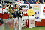 04 September 2004: Revolution defender Jay Heaps (leaning on signboard) watches second half action while taking a break from warming up. The San Jose Earthquakes defeated the New England Revolution 1-0 at Gillette Stadium in Foxboro, MA during a regular season Major League Soccer game..