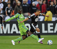 DC United forward Charlie Davies (9) shields the ball against Seattle Sounder defender Jhon Kennedy Hurtado (34) DC United defeated The Seattle Sounders 2-1, at RFK Stadium, Wednesday  May 4, 2011.