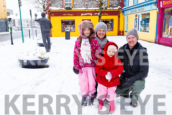 Shona Marcella Cora and Donal Griffin enjoying the snow in Listowel on Friday.
