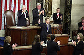 "Prime Minister Tony Blair of Great Britain gives a ""thumbs-up"" sign acknowledging the applause as he addresses a Joint Session of the United States Congress in the U.S. Capitol in Washington, DC on July 17, 2003.  The Prime Minister said America must ""listen as well as lead"" in the fight against terrorism.  Behind Prime Minister Blair are U.S. Vice President Dick Cheney, left, and the Speaker of the U.S. House of Representatives J. Dennis Hastert (Republican of Illinois), right.<br /> Credit: Ron Sachs / CNP"