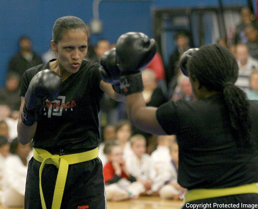 Fernanda Fernandes gives a demonstration at the Boston Taekwondo Academy graduation at Randolph High gym Saturday March 31, 2012.(Photo by Gary Wilcox)