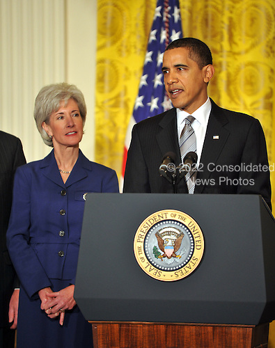 """Washington, D.C. - March 2, 2009 -- United States President Barack Obama, right, names Governor Kathleen Sebelius (Democrat of Kansas), left, as Secretary of the Department of Health and Human Services (HHS) in the East Room of the White House in Washington, DC on Monday, March 2, 2009.  The President also announced the release of $155 million authorized by the American Recovery and Reinvestment Act (ARRA) that will support 126 new health centers.  In a release, the White House stated """"These health centers will help people in need - many with no health insurance - obtain access to comprehensive primary and preventive health care services."""".Credit: Ron Sachs / Pool via CNP"""