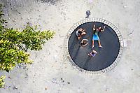Children play on a trampoline in Funafuti, Tuvalu. March, 2019.