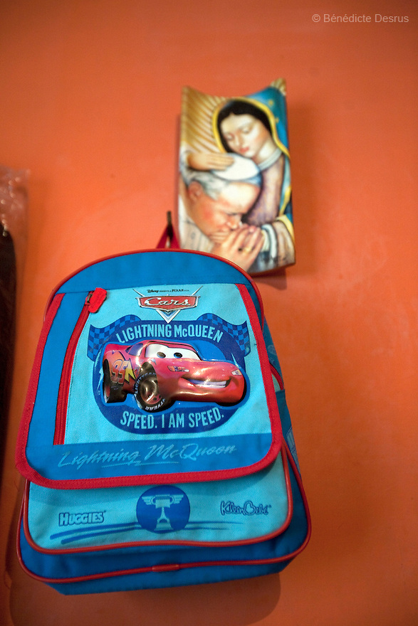 """April 26, 2009 - Mexico City, Mexico - Oscar's school bag hang in the wall of his parents' apartment in Mexico City. Oscar Corona Perez, 5 years old, died yesterday after 8 days of treatment at """"La Raza"""" national medical center. The family was told on Friday that the medication and operations that had been done had no effect as Oscar had a new illness with no treatment. The next morning he died at 11:00 AM of pneumonia caused by swine Flu. The death toll has risen to over 80 people in Mexico City, and 929 people have the disease. All dead bodies with the influenza must be cremated. Photo credit: Benedicte Desrus / Sipa Press"""