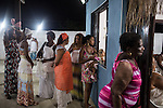 RIO DE JANEIRO, BRAZIL - JANUARY 24: Women worshippers watch the rituals during a candomble ceremony, in Rio de Janeiro, Brazil, on Saturday, Jan. 23, 2015. Brazil's Afro-Brazilian religions which in recent years have come under increasing threats and prejudice, particularly from the growing number of evangelical churches. Candombl&eacute; originated in Salvador, Bahia at the beginning of the 19th century when enslaved Africans brought their beliefs with them. Umbanda and candombl&eacute; are Afro-Brazilian religions practiced in mostly Brazil. <br /> (Lianne Milton for the Washington Post)