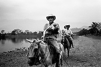 colombia1074 - civilians are caught in the crossfire between government troops and FARC guerrillas, near Puerto Rico, soon after 3 years of peace talks came to a sudden end. Caqueta march 2002<br />
