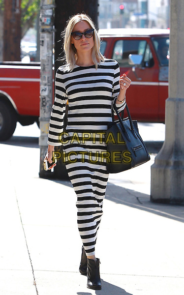 October 23 2014 West Hollywood California  Kristen Cavallari sporting a striped dress showing off her fabulous wedding ring while doing some shopping on Melrose Place before heading to a friends house<br /> CAP/MPI/Misa<br /> &copy;Misa/MPI/Capital Pictures