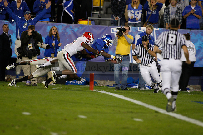 Wide receiver Chris Matthews leaps into the endzone to make the score 41-25 against Georgia at Commonwealth Stadium on Saturday, Oct. 23, 2010. Photo by Scott Hannigan | Staff