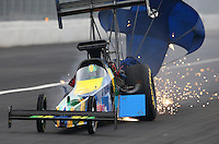 Feb 9, 2014; Pomona, CA, USA; NHRA top fuel dragster driver Sidnei Frigo blows an engine and tire during qualifying for the Winternationals at Auto Club Raceway at Pomona. Mandatory Credit: Mark J. Rebilas-