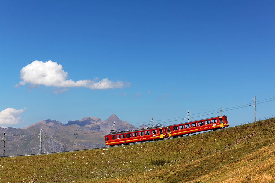 Red rail cars on the Jungfrau railway, Bernese Oberland, Switzerland