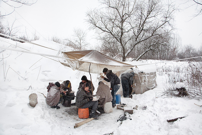 Serbia, Subotica, 04.02.2012: Migrants gather at a shelter at minus 25 degrees. After being stuck in the Jungle for days to months, a lot of them loose their hope for a better life realizing the uncertain&nbsp;future and their imagination of Europe superseded. <br />