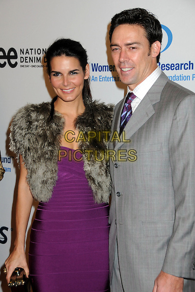 ANGIE HARMON & JASON SEHORN.EIF's Women's Cancer Research Fund Benefit held at the Beverly Wilshire Hotel, Beverly Hills, California, USA..January 27th, 2010.half length purple dress grey gray beige fur wrap jacket gilet jacket  married husband wife.CAP/ADM/BP.©Byron Purvis/AdMedia/Capital Pictures.