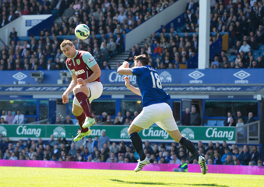 Burnley's Sam Vokes out jumps Everton's Gareth Barry but heads wide of the goal<br /> <br /> Photographer Stephen White/CameraSport<br /> <br /> Football - Barclays Premiership - Everton v Burnley - Saturday 18th April 2015 - Goodison Park - Everton<br /> <br /> &copy; CameraSport - 43 Linden Ave. Countesthorpe. Leicester. England. LE8 5PG - Tel: +44 (0) 116 277 4147 - admin@camerasport.com - www.camerasport.com